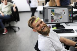 Man happy in his work in a well-lit, comfortable office
