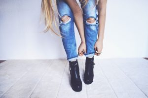 Woman wearing jeans and boots